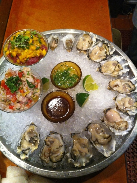 Frontera seafood platter with 2 ceviches, 3 kinds of oysters, salsa negra, sour orange miñoneta
