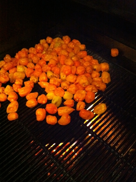 Habaneros roasting over the wood grill for habanero-lime-roasted garlic salsa for Xoco's cochinita pibil torta