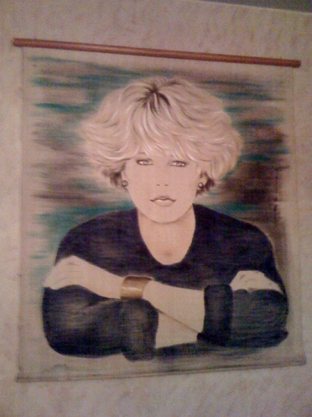 Our apt's 5-foot tall Meg Ryan painting.