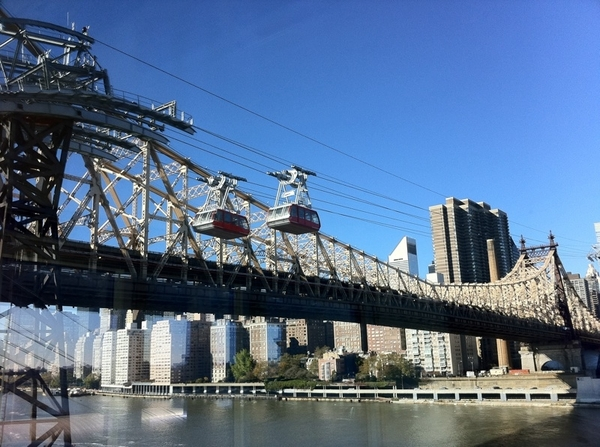 A first! New feature of the Roosevelt Island Tram. Two moving in the same direction. Cool!