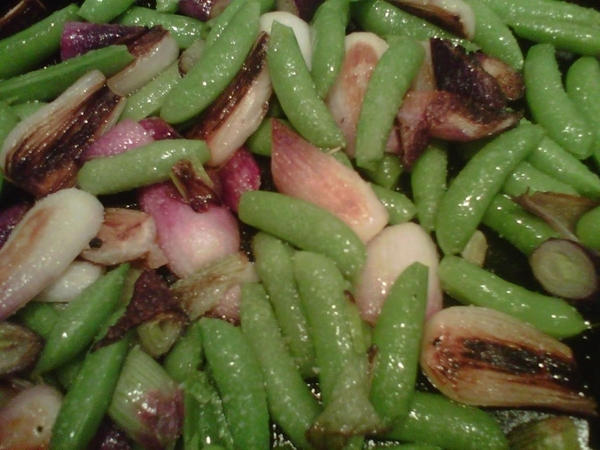 Chef Zach is making the first sugar snap peas and caramelized red knob onions for a private dinner n resto library