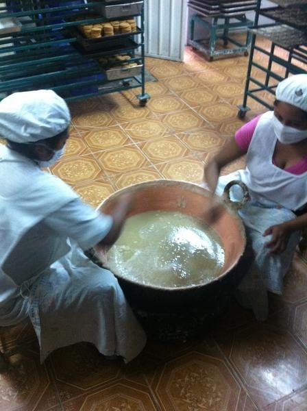 Puebla artisanal sweets kitchen: beating the jamoncillo de pepita (pumpkinseed fudge) for tortitas de Santa Clara