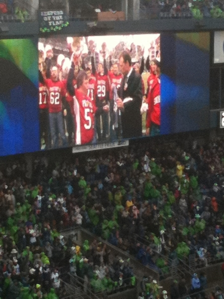 Ike Ditzenberger and Snohomish HS teammates on the video screen at Qwest Field. #spiritof12