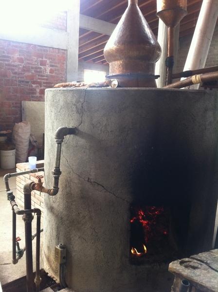 Fidencio Mezcal Distlry, Oax: small copper still distillation of fermented agave.