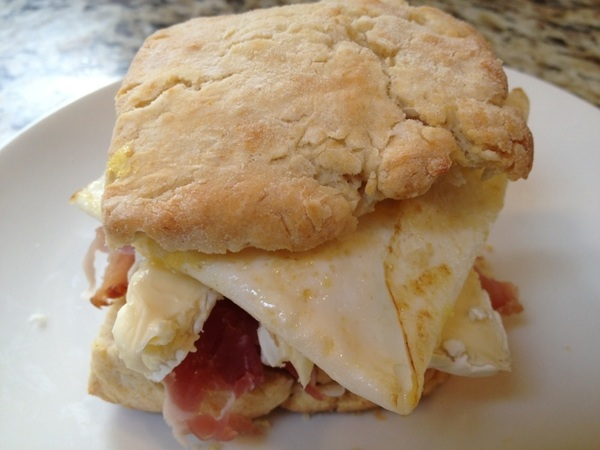 Biscuit topped with speck, double cream Brie, red onion and a fried duck egg. A happy Sunday morning it is