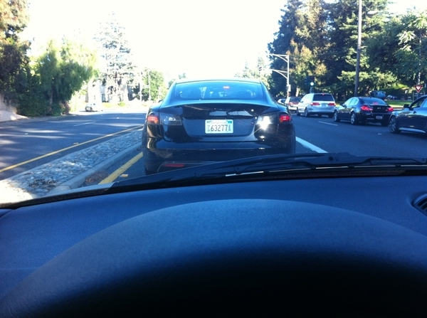 Spotted: Tesla model S on the road.  No badging, manufacturers plates. About a mile from Tesla headquarters.