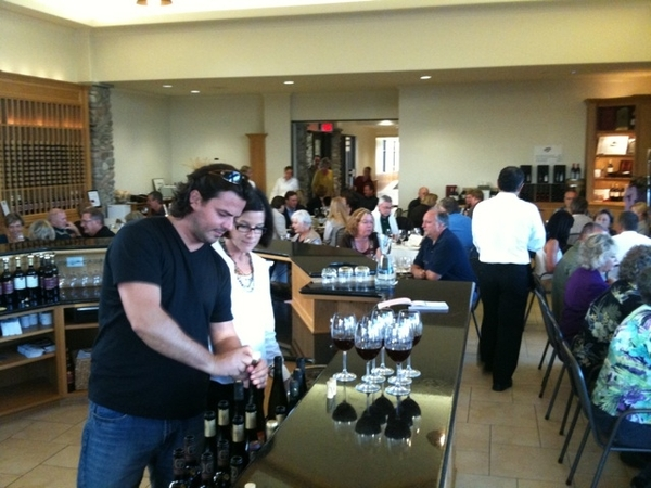 Zoltan Szabo opens wines for the harvest food & wine pairing at Viewpointe winery.