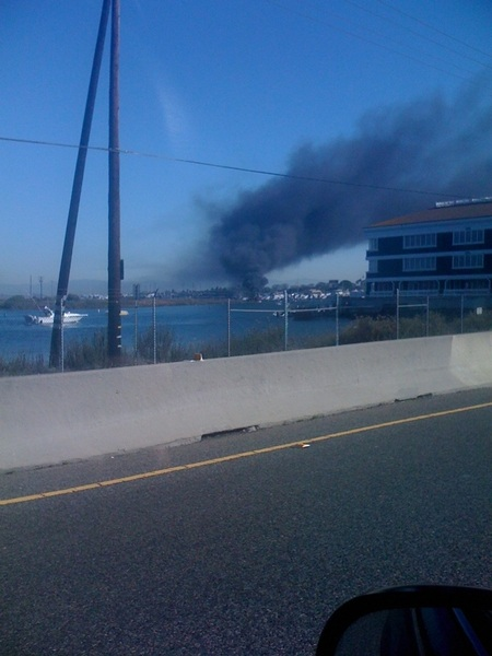Boat on fire in the marina at Sunset Beach. Hope they are ok. Looks bad.