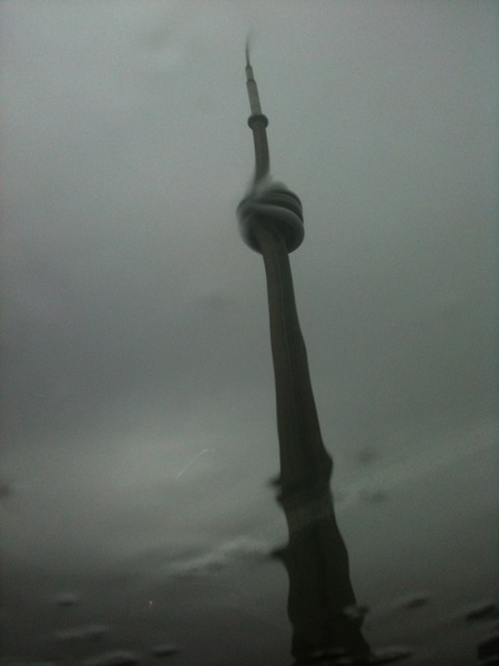 CN Tower thru my rain-splashed sunroof while stopped in traffic. Contemplating which wine to open tonight.