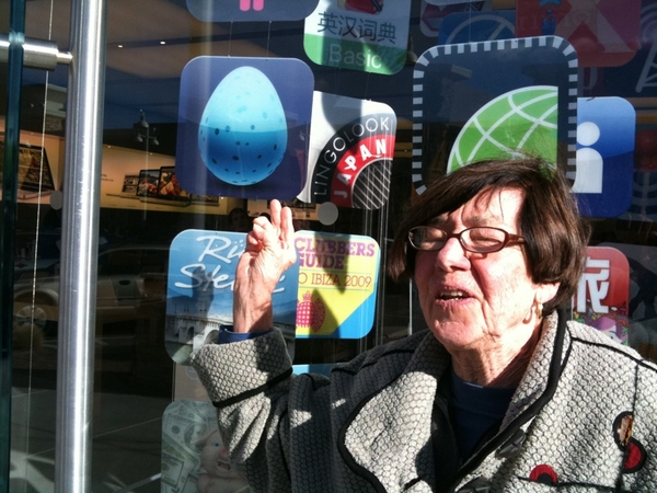 My mom, 80 this year, happy at  Store with her first iPhone