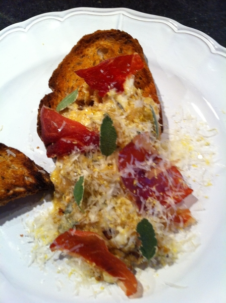 "Made brunch:eggs scrambled w carm onions,Stilton,sage. Top:Prosciutto ""chips,""sage,Romano,lemon zest.Country toast"