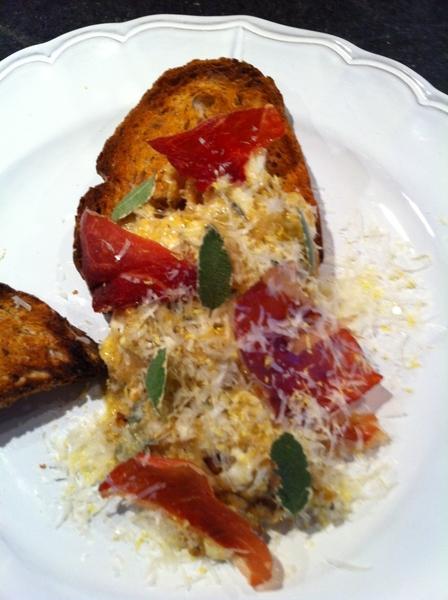 "Made brunch:eggs scrambled w carm onions,Stilton,sage. Top:Prosciutto ""chips,""sage,Romano,lemon zest.Country toast"