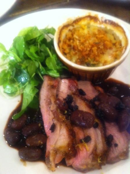 Adobe Guad dinner: rst lamb w pasilla-bl olive-red wine sauce; farm-stand veg gratin (fennel,romesco broc),arugula