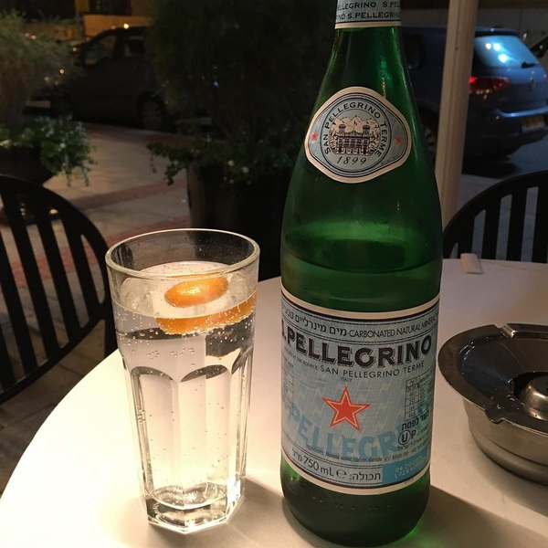 After 13 hours in the office today. I'm relaxing with Sam Pellegrino and a splash of citrus. I could have something harder but meh.