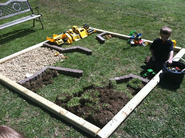 What a fun backyard idea for kids with all those Tonka trucks and John Deere tractors.