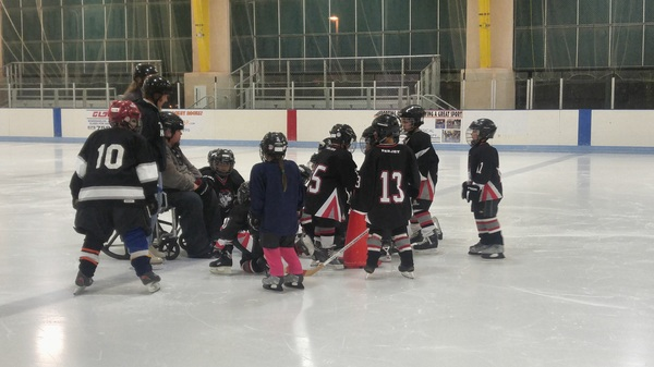 Huddle up! #minimites #taoshockey #taos #nm