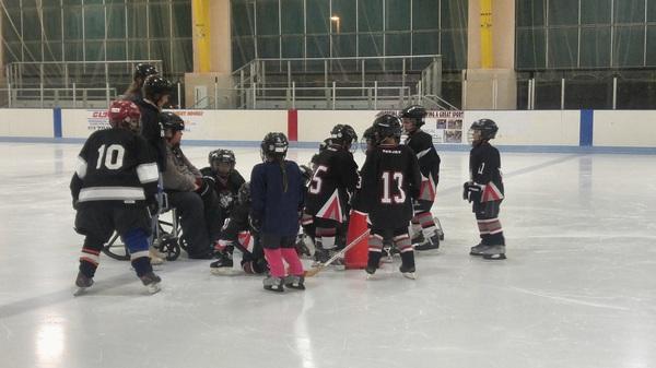 Huddle up! #minimites #taoshockey #taos #nm